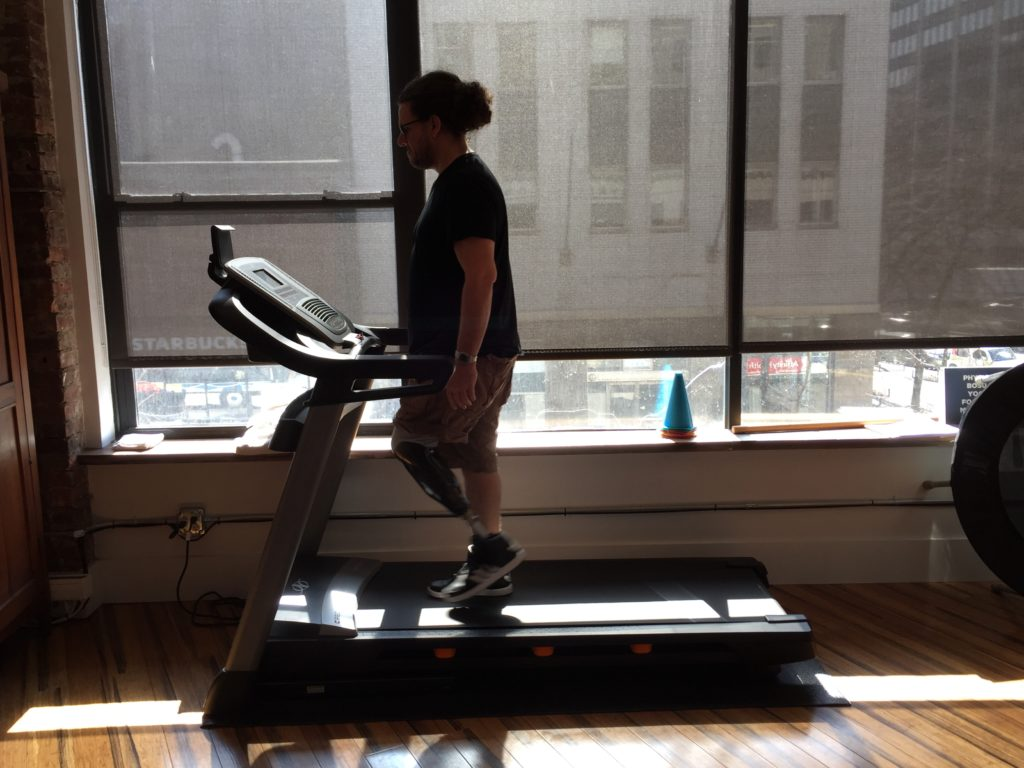Gwen Le Pape testing his prosthetic on the treadmill.