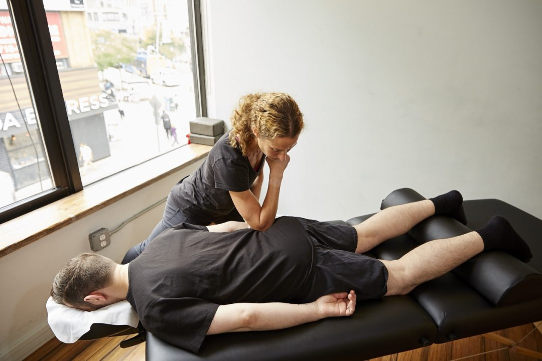 Amy Montia, LMT performing Deep Tissue Massage at Physio Logic NYC in Brooklyn, NY.