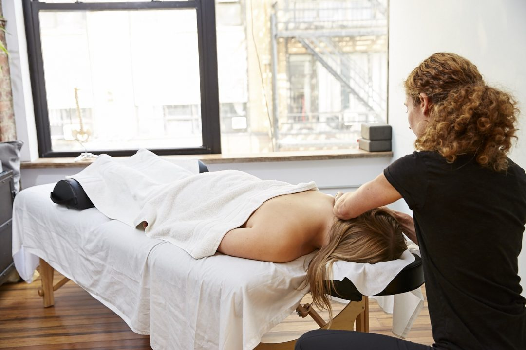 Amy Montia, LMT performing Swedish Massage at Physio Logic NYC in Brooklyn, NY.