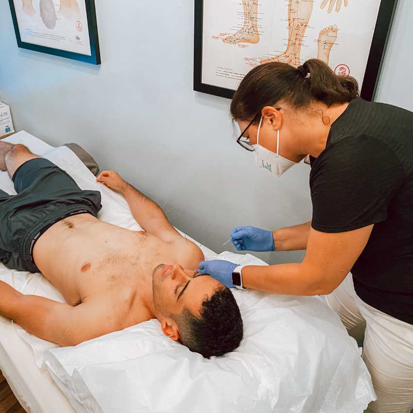 Man getting acupuncture for anxiety at Physio Logic NYC in Brooklyn, NY.