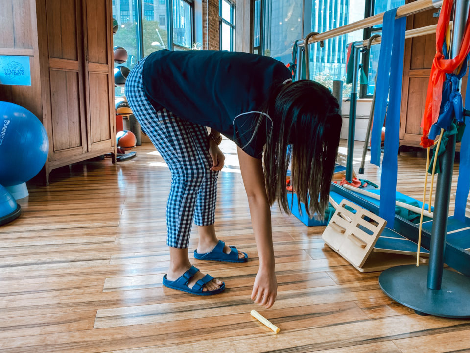 Dr. Eva Shi, Physical Therapist at Physio Logic NYC in Brooklyn, NY, demonstrates why you may have lower back pain from bending over.